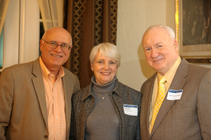 From left to right: David Hahn, Barbara Lukaszewski, and James Lukaszewski enjoy the welcoming reception at David Nour's home